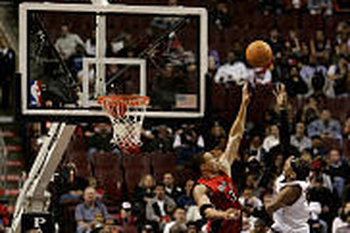 As the shot clock winds down, 76ers' Allen Iverson, right, takes a shot against the Toronto Raptors.