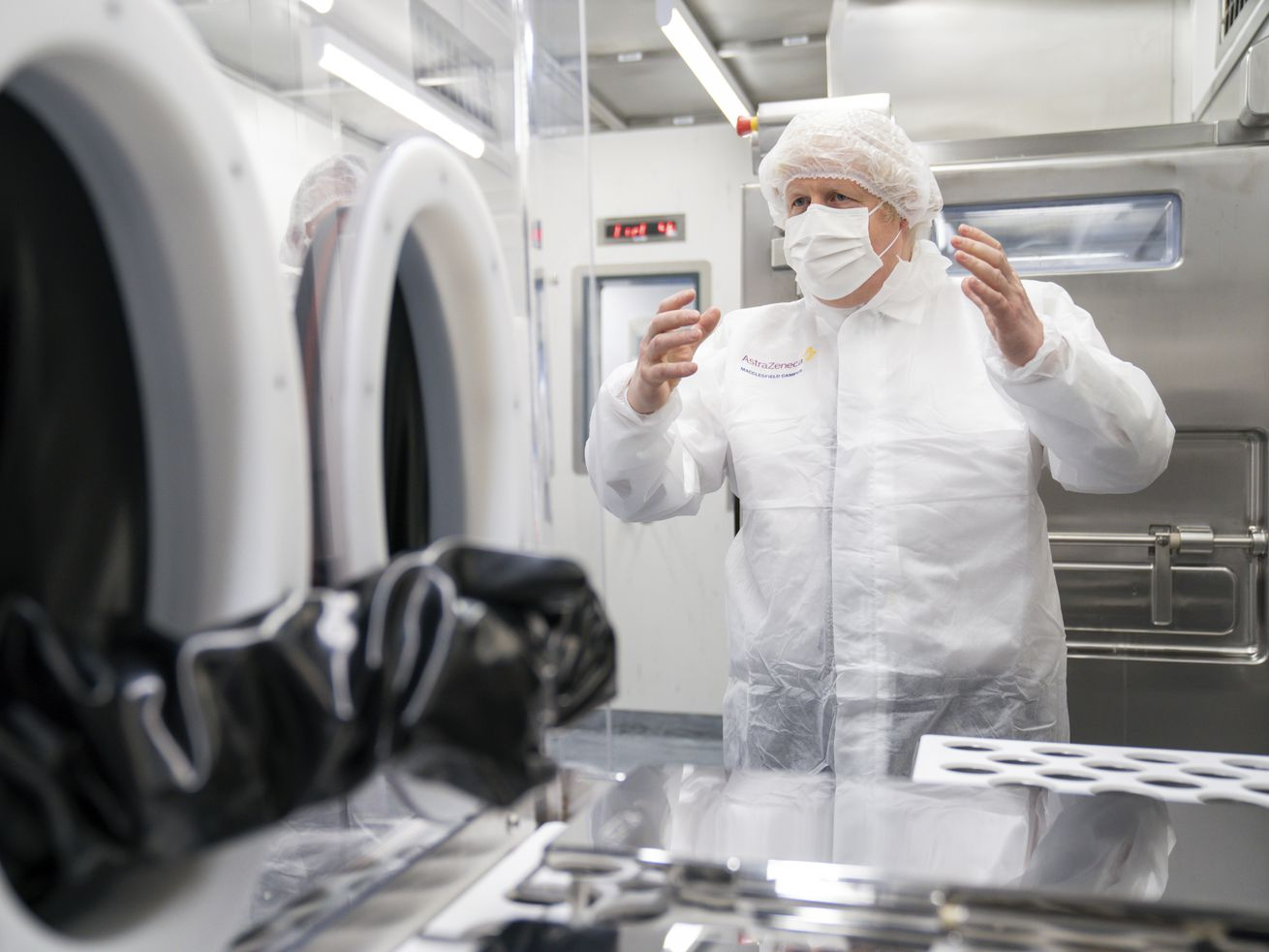 Britain's Prime Minister Boris Johnson visits AstraZeneca facility in Macclesfield, England, on Tuesday April 6, 2021, to learn more about their dollars 500 million investment into the site.