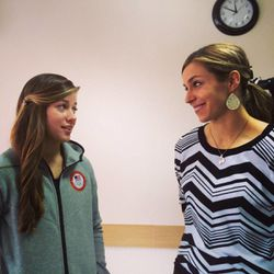 Noelle PIkus-Pace visits with U.S. luger and BYU student Kate Hansen following church services in Sochi, Russia.