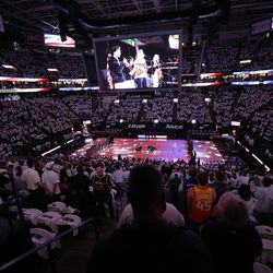 Fans stand for the National anthem as the Utah Jazz and the Memphis Grizzlies play in game one of their NBA playoff series at Vivint Arena in Salt Lake City on Sunday, May 23, 2021.