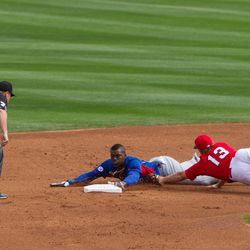 Soler hustles into second ahead of the tag -