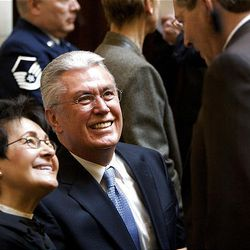 President Dieter F. Uchtdorf second counselor in the First Presidency of the Church of Jesus Christ of Latter-day Saints and his wife Harriet Reich Uchtdorf greet legislators and others prior to President Uchtdorf saying the opening prayer at the start of the 2009 session of the Utah Legislature at the Capitol building in Salt Lake City, Monday.