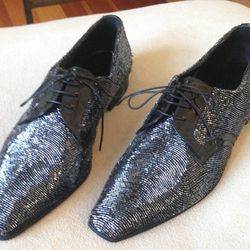 """Alexander McQueen shoes, price unknown. """"I have an epic selection of original Lee McQueen, including these terribly impractical bugle bead lace-ups."""""""