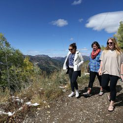 Caoimhe Odwyer, Sarah Lapp and Julia Heller explore a trail while looking for yellow leaves near Guardsman Pass on Wednesday, Sept. 20, 2017.