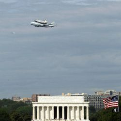 The Space Shuttle Discovery, mounted on the Shuttle Carrier Aircraft, flies over the Lincoln Memorial in Washington, Tuesday, April 17, 2012. Discovery is en route from Kennedy Space Center to the Smithsonian National Air and Space Museum Udvar/Hazy Center at Dulles International Airport.