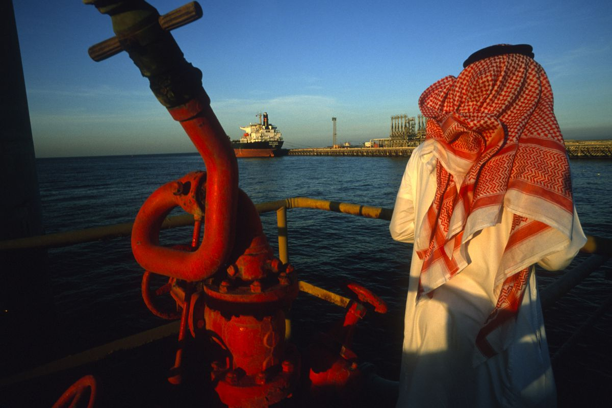A man stands on a platform on an oil and gas terminal on January 2003 in n the Persian Gulf off of Ras Al Tanoura, Saudi Arabia.