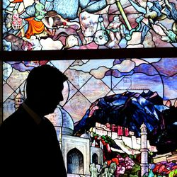 """Utah Valley University President Matthew Holland looks at the progress of """"Roots of Knowledge"""" at Holdman Studios at Thanksgiving Point in Lehi on Friday, Sept. 16, 2016. A Guardian UK reporter called the work """"one of the most spectacular stained glass windows made in the past century."""""""