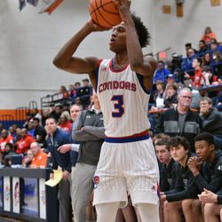 Curie's DaJuan Gordon (3) puts in a three-pointer against New Trier, Friday 12-28-18. Worsom Robinson/For Sun-Times