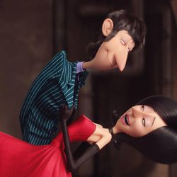"""The world's first-ever female supervillain, Scarlet Overkill (voiced by Sandra Bullock) dances with husband Herb (Jon Hamm) in """"Minions."""""""