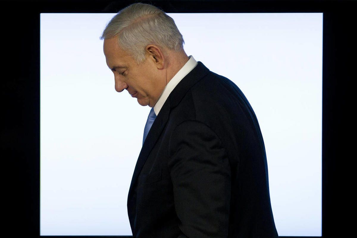 Israeli Prime Minister Benjamin Netanyahu leaves after a press conference in Jerusalem, Tuesday, April 3, 2012. Netanyahu said that the planned evacuation of a group of Jewish settlers who illegally occupied a West Bank house has been put on hold.