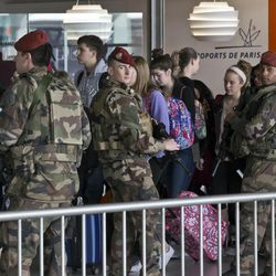 French soldiers patrol at Charles de Gaulle airport, in Roissy, north of Paris, Tuesday, March 22, 2016. Authorities are tightening security at airports and on the streets of European cities after attacks on the Brussels airport and subways system that killed at least one person and injured many others. Security has been beefed up in France, Austria, Poland and the Czech Republic.