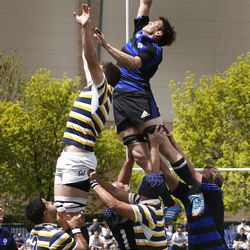 BYU's TJ Allred tips the ball as BYU defeats Cal 27-24 in rugby on a drop as time expires to win the Varsity Cup national championship Saturday, May 4, 2013, in Provo.