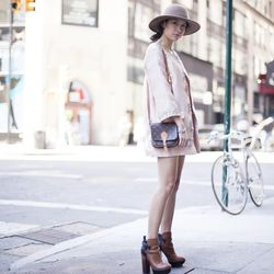 """Rachel of <a href=""""http://www.thatschic.net""""target=""""_blank"""">That's Chic</a> is wearing a Ti Mo coat, a Hanes tank top, vintage Levi's shorts, Dolce Vita boots, and a Brixton hat."""