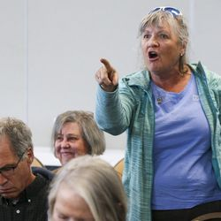 Jamie Zayac shouts a question on the impeachment inquiry at Rep. Ben McAdams, not pictured, following a town hall on aging adult and senior issues at the Midvale Senior Center in Midvale on Friday, Oct. 4, 2019. McAdams had delivered a statement on the inquiry before the town hall and spoke with the press and citizens following the event as well.
