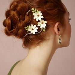 """Twining Asters Hairpins: $325 for set of two, <a href=""""http://www.bhldn.com/shop-shoes-accessories-headpieces/twining-asters-hairpins-2/productoptionids/7320011a-5df4-4a31-9001-39a0b62ba4e8"""">BHLDN</a>"""