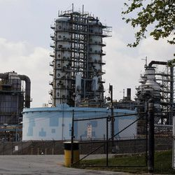 In a Thursday, April 19, 2012 photo, the ConocoPhillips refinery is seen in Trainer, Pa.  ConocoPhillips on Monday, April 23, 2012 reported first-quarter earnings of $2.9 billion, compared with first-quarter 2011 earnings of $3.0 billion. Excluding $330 million of special items, first-quarter 2012 adjusted earnings were $2.6 billion. Special items were primarily related to gains on asset dispositions, partially offset by impairments and repositioning costs.