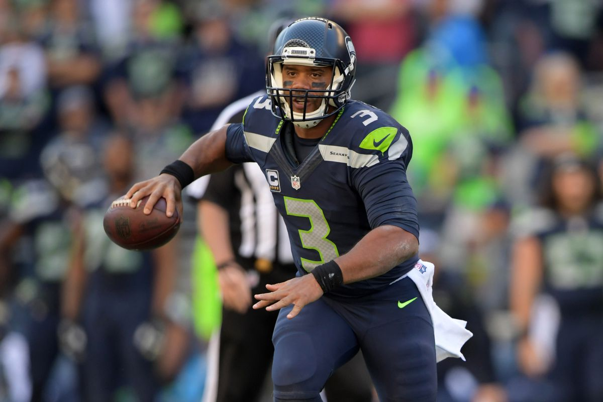 Seattle Seahawks quarterback Russell Wilson throws a pass against the Miami Dolphins during a NFL game at CenturyLink Field. The Seahawks defeated the Dolphins 12-10.