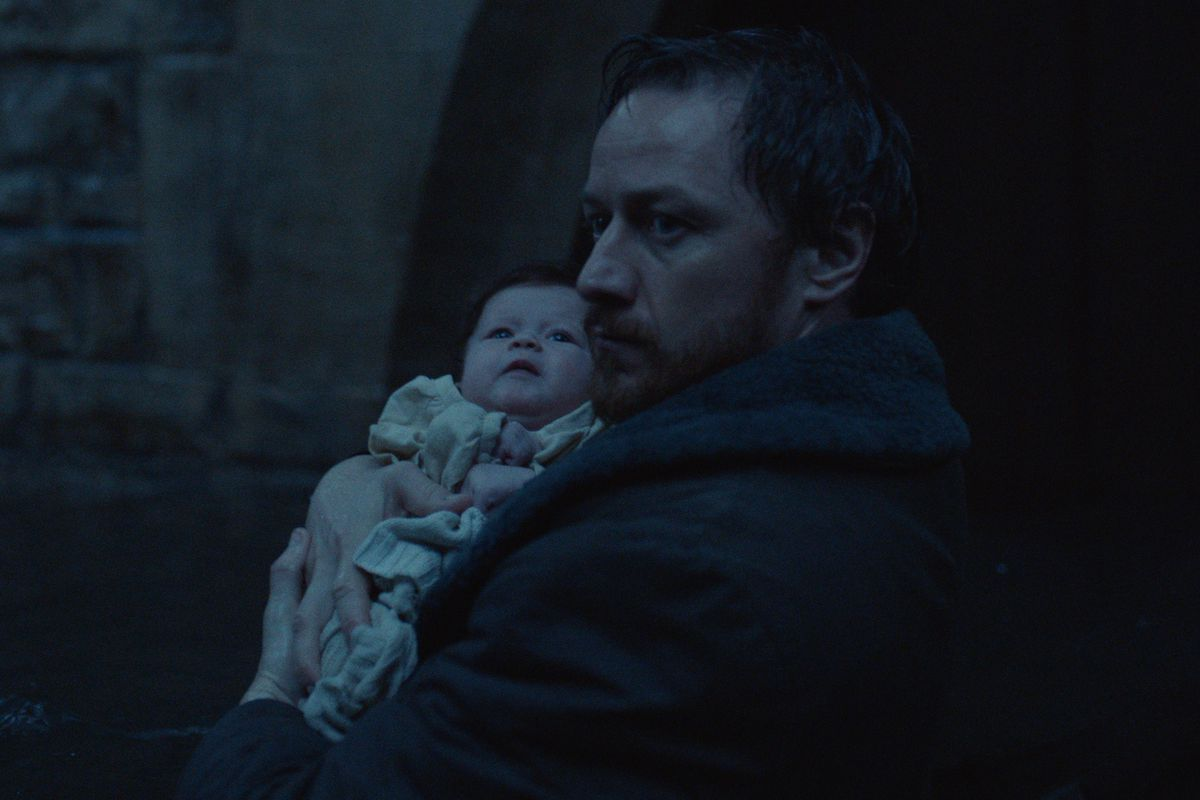 james mcavoy as Lord Asriel, carrying a baby Lyra to Jordan College
