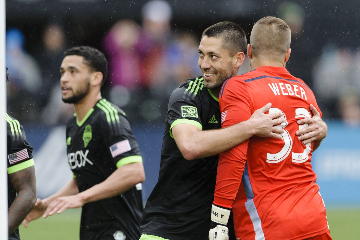 Seattle Sounders FC forward Clint Dempsey (2) hugs Portland Timbers goalkeeper Andrew Weber (33) after scoring a goal during the second half at Providence Park. The game ended in a 4-4 draw.