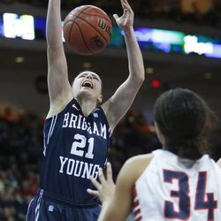 Brigham Young Cougars guard Lexi Eaton (21) has the ball knocked away during the West Coast Conference championship game in Las Vegas Tuesday, March 11, 2014. BYU lost 71-57.