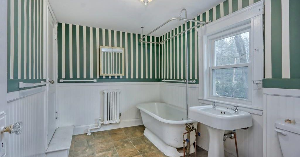 Jamaica Plain colonial with potential on sale for well under $700,000