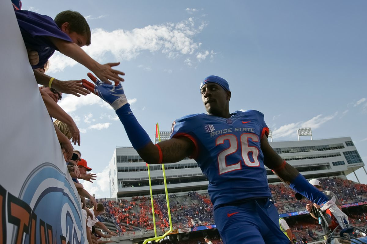 BOISE, ID - OCTOBER 01:  Quaylon Ewing-Burton #26 of the Boise State Broncos greets fans after the game against the Nevada Wolf Pack at Bronco Stadium on October 1, 2011 in Boise, Idaho.  (Photo by Otto Kitsinger III/Getty Images)
