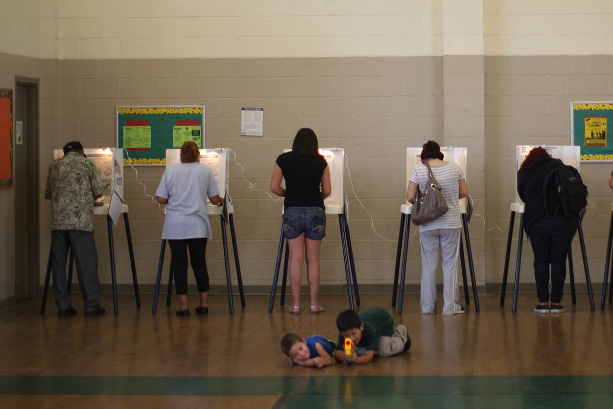 People vote at a school in the predominantly Latino Boyle Heights area in Los Angeles, California.