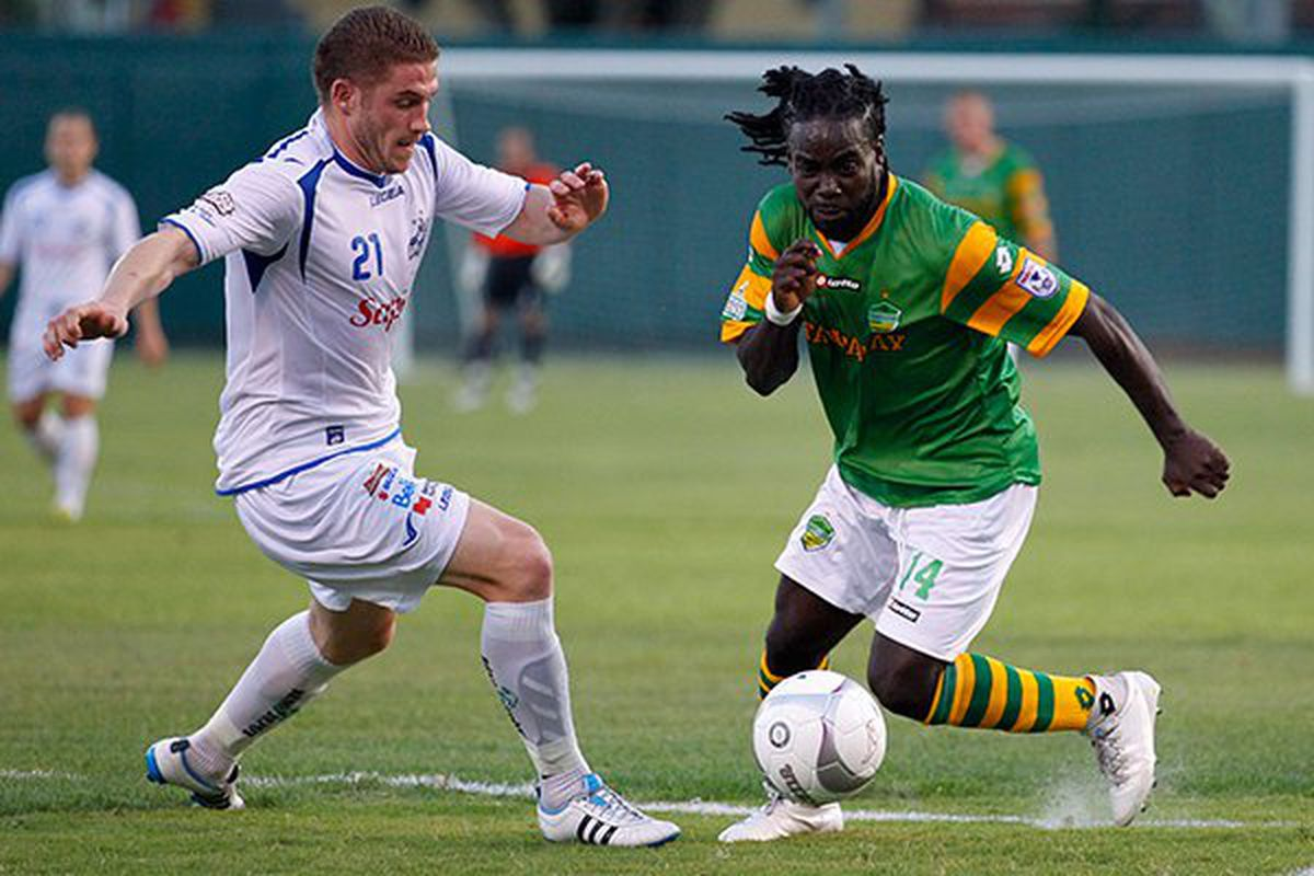 FC Tampa Bay's Pascal Millien drives forward with the ball.