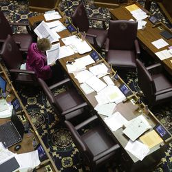 Rep. Sheila Klinker, D- Lafayette, reads as she sits at her desk during a session at the Statehouse Tuesday, April 28, 2015, in Indianapolis. The General Assembly adjourns on Wednesday.