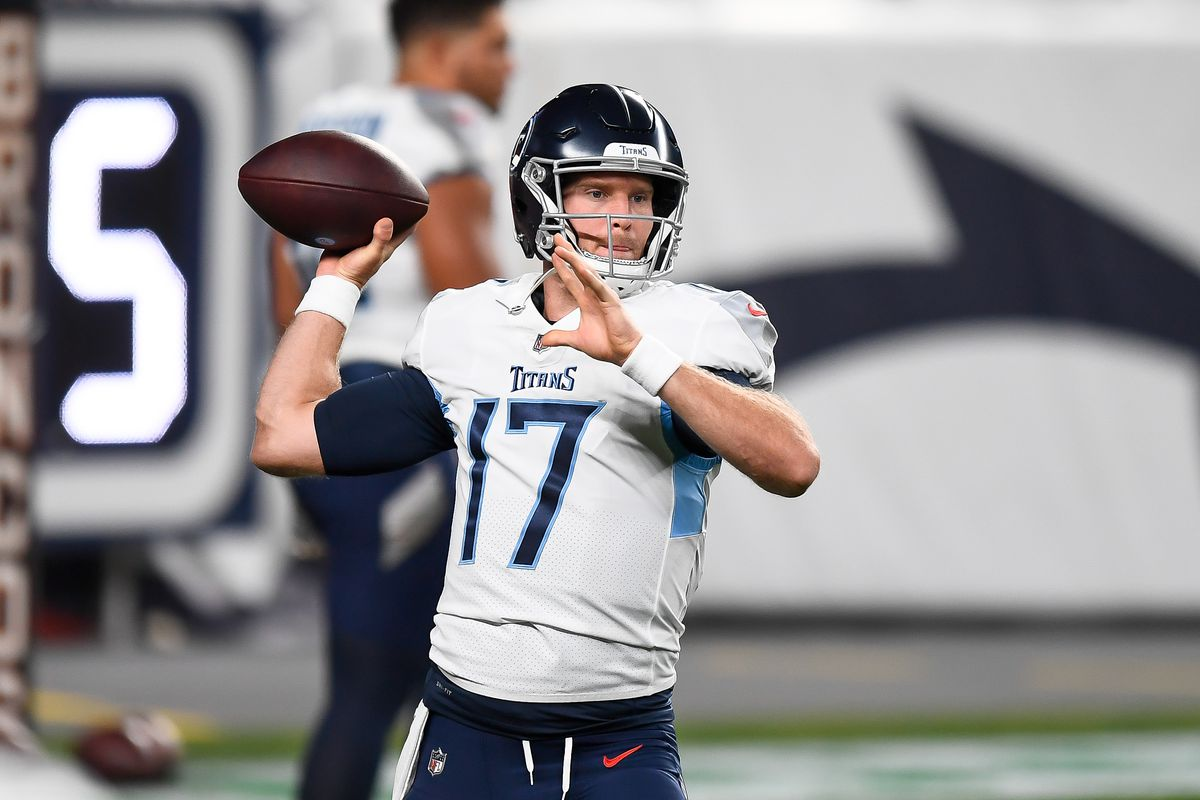 Ryan Tannehill of the Tennessee Titans warms up before a game against the Denver Broncos at Empower Field at Mile High on September 14, 2020 in Denver, Colorado.