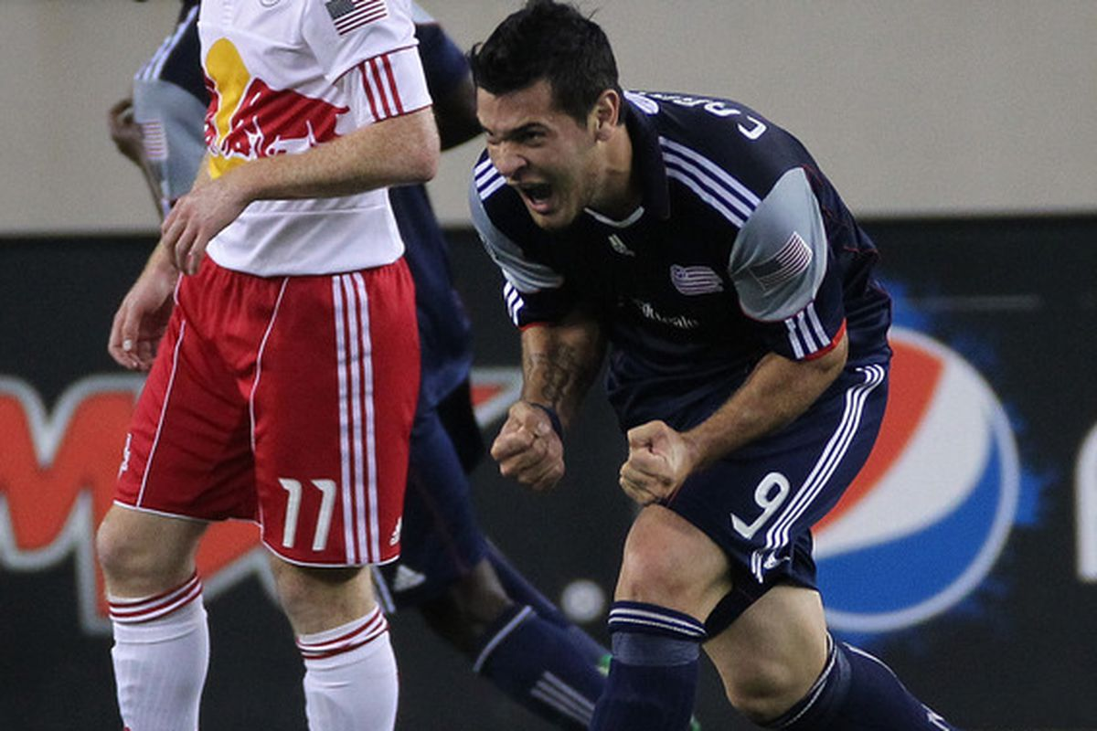 FOXBORO, MA - AUGUST 20:  Milton Caraglio #9 of the New England Revolution reacts after he scored on the New York Red Bulls at Gillette Stadium on August 20, 2011 in Foxboro, Massachusetts. (Photo by Jim Rogash/Getty Images)