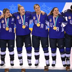 Gold medal winners the United States celebrate during the victory ceremony after defeating Canada in a shootout.