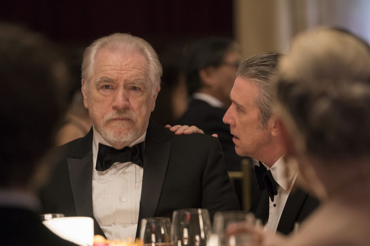 Logan and Connor in tuxedos at a gala on Succession