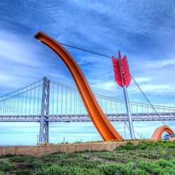 Rincon Park's <strong>Cupid's Span</strong> is a permanent prop for engagement shoots. The 60-foot tall sculpture was designed by Claes Oldenburg and Coosje van Bruggen and gifted to the city by the founders of Gap. The location also comes with the Bay Br