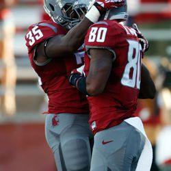 Marcus Mason and Dom Williams celebrate a touchdown