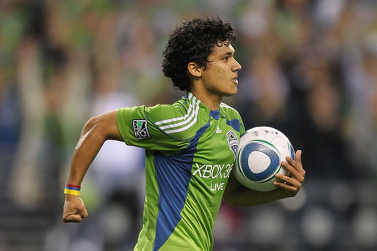 SEATTLE - AUGUST 28:  Fredy Montero #17 of the Seattle Sounders FC pumps his fist after scoring in the first half against the Chicago Fire on August 28 2010 at Qwest Field in Seattle Washington.  (Photo by Otto Greule Jr/Getty Images)
