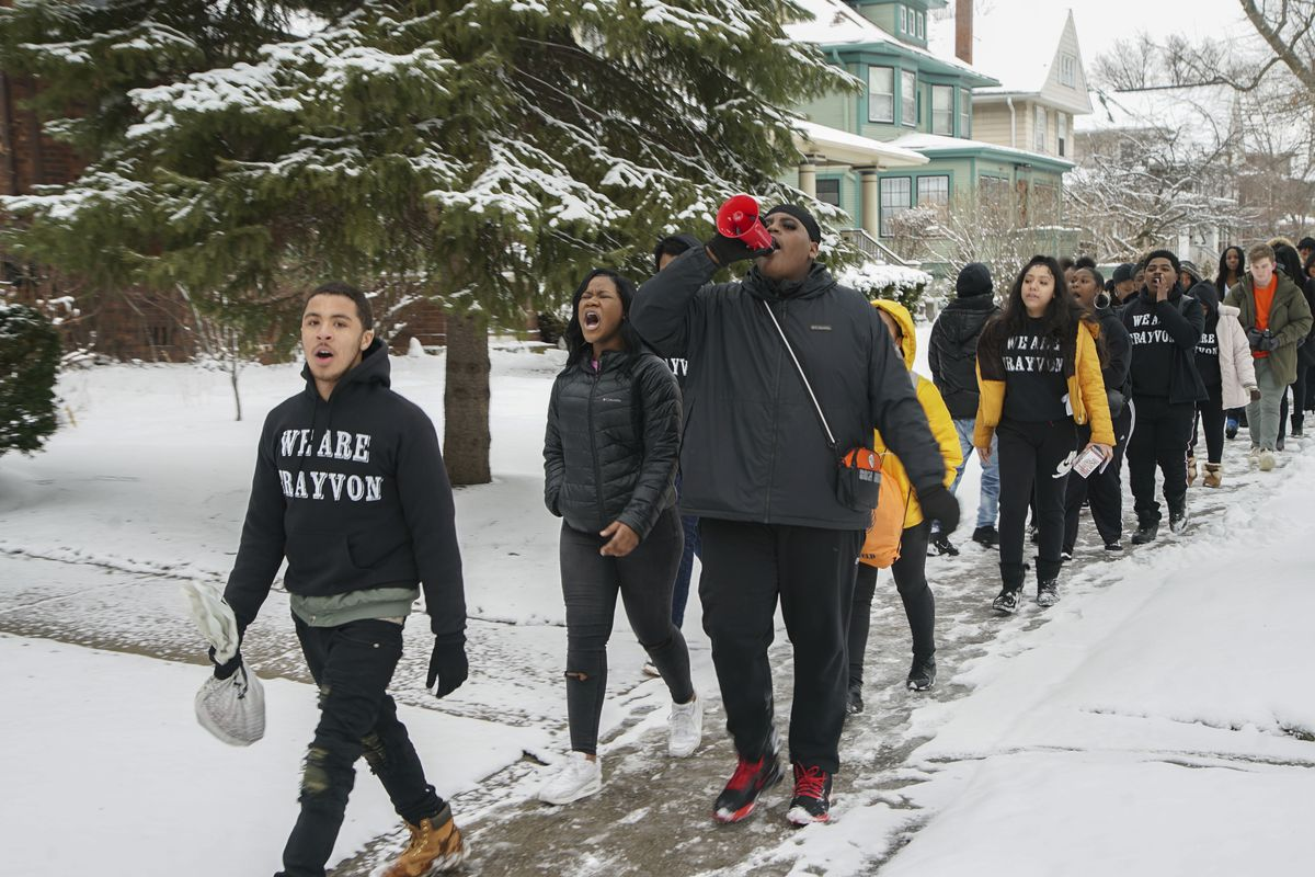 Oak Park and River Forest High School students march to a rally at Oak Park Village Hall to protest police violence in honor of Trayvon Martin, Wednesday, Feb. 26, 2020.