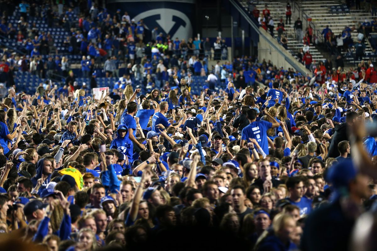 Fans swarm the field after BYU beat Utah in at LaVell Edwards Stadium in Provo on Saturday, Sept. 11, 2021. BYU won 26-17.