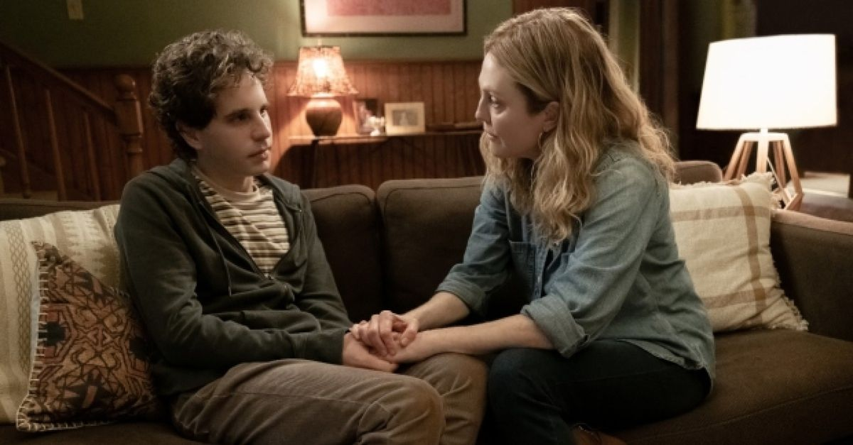 Evan Hansen and his mother sit on a couch. She is singing.