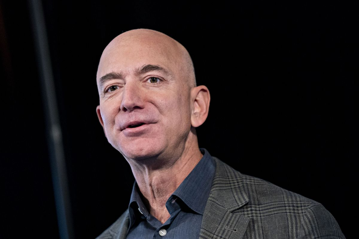 A close-up of Amazon CEO Jeff Bezos's face with a neutral expression.