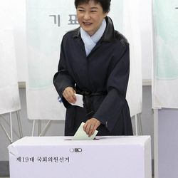 Park Geun-hye, head of the ruling Saenuri Party's interim governing body, casts her votes for the parliamentary election at a polling station in Daegu, south of Seoul, South Korea, Wednesday, April 11, 2012.