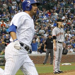San Francisco Giants starting pitcher Tim Lincecum, right, watches Chicago Cubs' David DeJesus' two-run home run as DeJesus rounds first, during the third inning of a baseball game, Saturday, Sept. 1 2012, in Chicago.