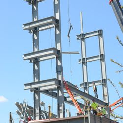 2:06 p.m. More beams being lowered into place -