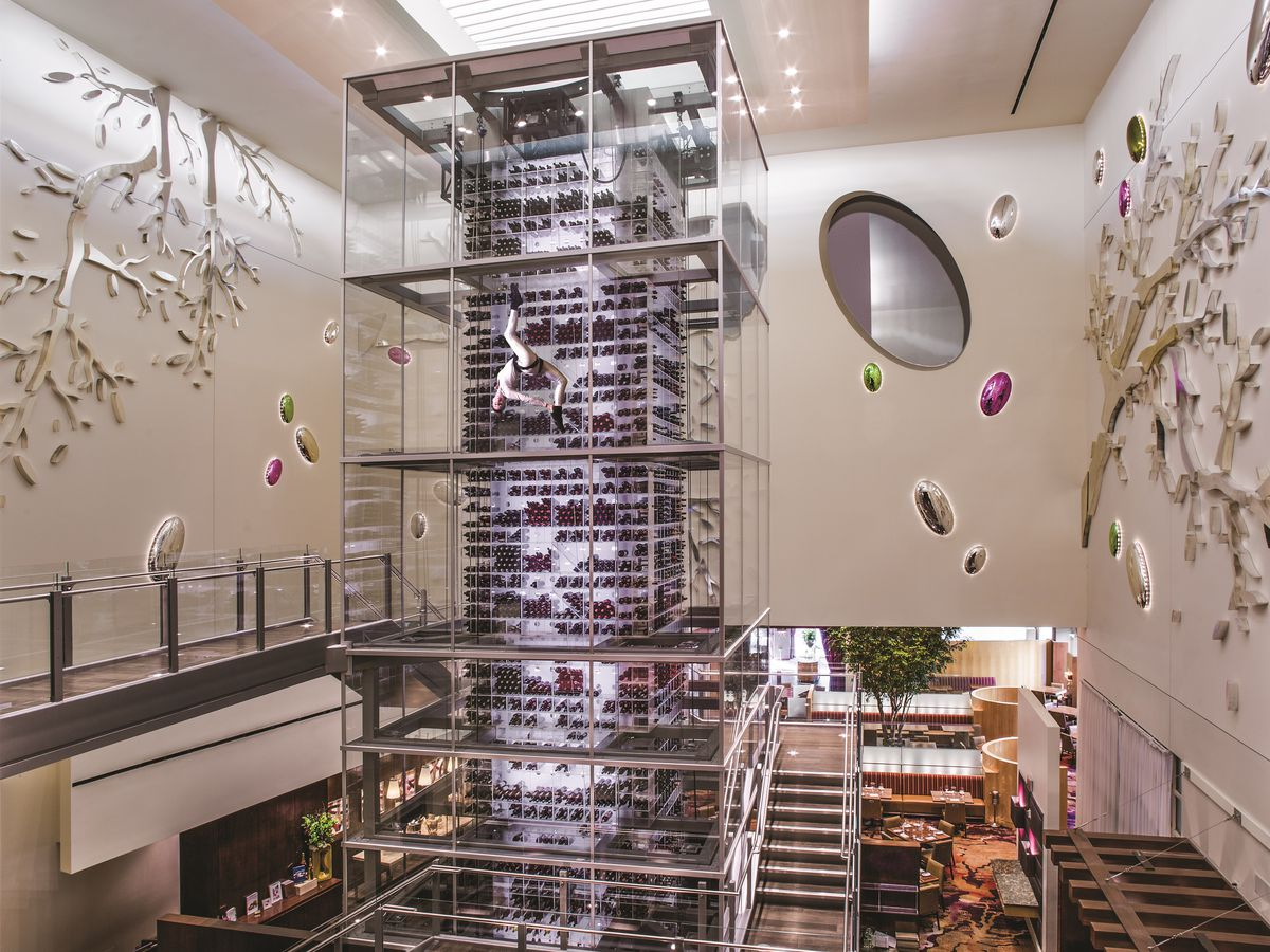 A wine tower in a restaurant