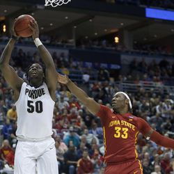Purdue's Caleb Swanigan (50) goes up for a basket against Iowa State's Solomon Young (33) during the first half of an NCAA college basketball tournament second-round game Saturday, March 18, 2017, in Milwaukee. (AP Photo/Kiichiro Sato)