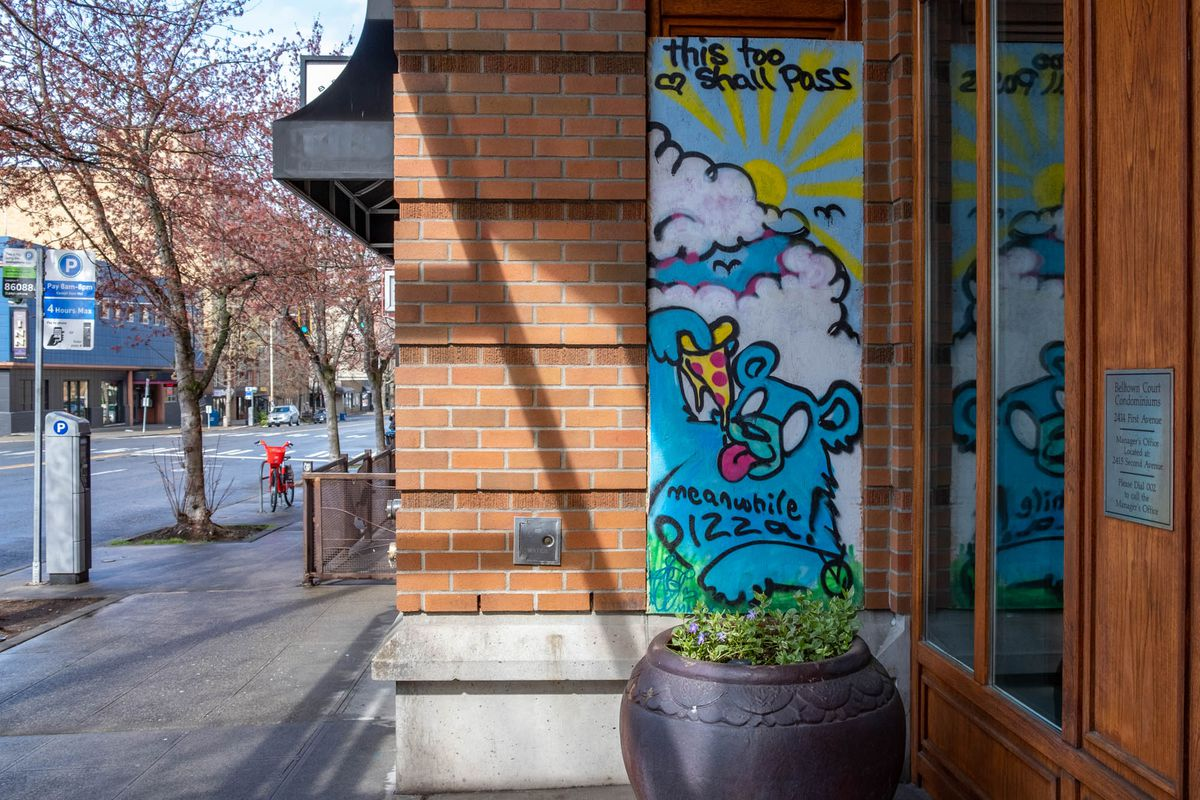A colorful mural outside Belltown Pizza with a cartoon bear