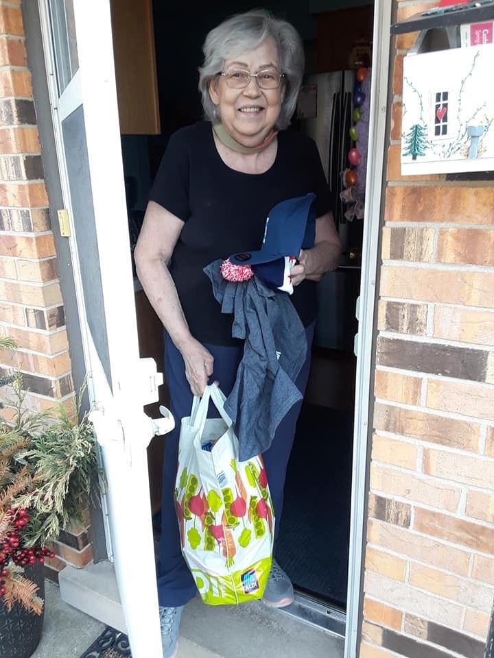 """Roberta Kaminski, a senior citizen impacted by the coronavirus outbreak and its attendant stay-at-home order, receives a care package from the """"Senior Relief Project"""" started by businessman Early Walker."""