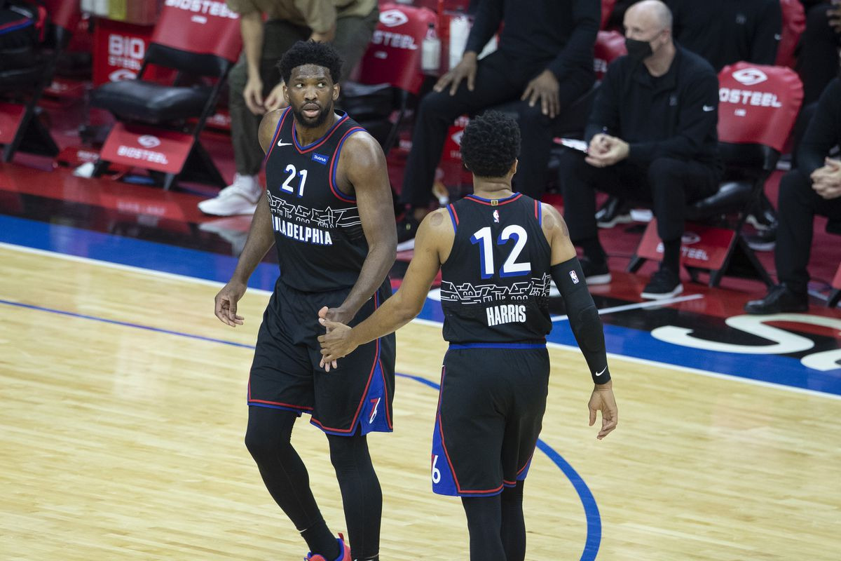 Joel Embiid and Tobias Harris of the Philadelphia 76ers react against the Detroit Pistons in the first quarter at the Wells Fargo Center on May 8, 2021 in Philadelphia, Pennsylvania.