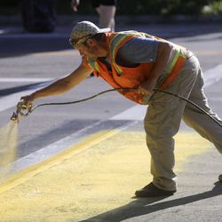 Jeremy Paxton, a foreman with Peck Striping, paints a crosswalk at the intersection of 300 East and 700 South in Salt Lake City on Wednesday, Sept. 4, 2019. The Salt Lake City Mayor's Office, Spin and Bike Utah are partnering to turn the intersection into a multi-modal community space.