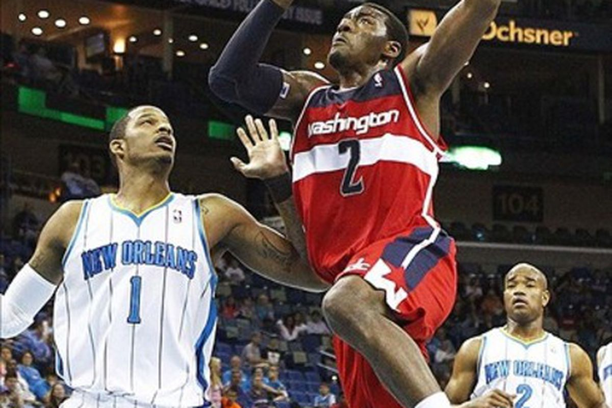 Mar 15, 2012; New Orleans, LA, USA; Washington Wizards guard John Wall (2) goes up for a basket beside New Orleans Hornets guard Trevor Ariza (1) during the second quarter at the New Orleans Arena. Mandatory Credit: Crystal LoGiudice-US PRESSWIRE